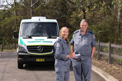 Patient Transport Service staff with vehicle